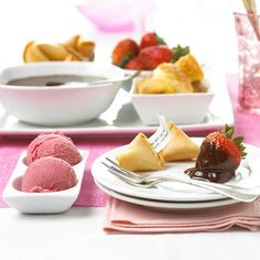 Rum-Laced Chocolate Fondue        This easy treat is easy, pretty, romantic -- and ready in minutes. Serve it with fortune cookies, petite croissants, and fresh strawberries.