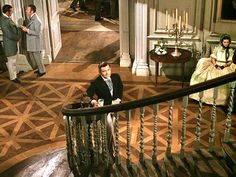 Rhett Butler at the bottom of the stairs at Twelve Oaks, where he first sees Scarlett O'Hara for the first time