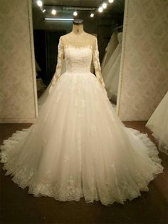 Long Sleeves Lace Wedding Gowns Sheer Back with Pearls - Elegant and classy, this chic bridal gown is sure to make a statement at your wedding. It features scoop neckline and sheer long sleeves, the sheer v-cut back is decorated with pearls, creating a lavish look. The natural waist leads to the full-length a-line silhouette hem with a chapel train.