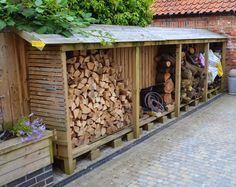 Log store at The Old Bakehouse, Norwell, Nottinghamshire