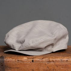 18 Waits | Billy Cap | Grey Chambray $115  Billy Caps are hand-made in Montreal. Based on a vintage pattern and updated by 18 Waits. Wool is sourced from Woolrich Woolen Mills in Pennsylvania. This Fall/Winter we are offering three variations: charcoal herringbone, light grey herringbone, and brown plaid. Trimmed with a super-soft leather sweatband.