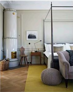 Love this airy, simple bedroom – and the surprise of yellow, too.