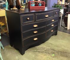 What a difference the right hardware does to a repurpose. The copper kettle cup handles and pull knobs are all the accent this dresser needed after it was painted with Dixie Belle Paint Company mineral paint in Midnight Sky. Nancy then distressed the edges to the natural wood. A perfect repurpose from Just Repurposed in Alabama