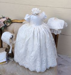 VIVIANA The VIVIANA by Elena ,Christening gown and bonnet, is made with heavily hand beaded Alençon lace. Featuring puff sleeves decorated with delicate Venetian trim and tide back sash. This dress is