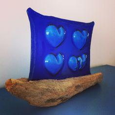 Glass art from Camber Lights, featuring driftwood from #CamberSands beach