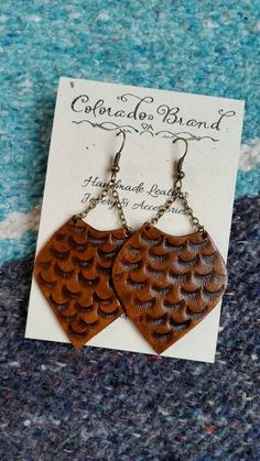 Check out this item in my Etsy shop https://www.etsy.com/listing/492645238/hand-tooled-leather-earrings-textured Leather Art, Leather Crafts, Tooled Leather, Leather Projects, Leather Tooling, Leather Earrings, Boho Earrings, Leather Jewelry, Essential Oil Jewelry