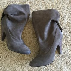 Grey slouchy suade ankle booties by Ash size 39 Brand new, Grey slouchy suade ankle booties by Ash. Button tab closure in back. They have the destructed look around the front and back of the shoe. Approximately 4 in heel. Great booties with skinny jeans, shorts, skirts in a wear with everything color. Pet/smoke free home Ash Shoes