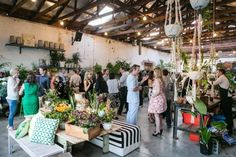 Glasshaus Inside is a Melbourne warehouse wedding venue with botanical plants draping from the walls is a modern take on the Gardens of Babylon.