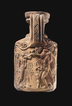A ROMAN RED-WARE POTTERY JUG  CIRCA 3RD CENTURY A.D.