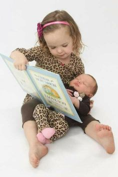 Sibling picture idea :) mayzee does love to read