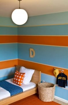 Boys room in orange and blue stripes.   The three paint colors used were Ebbtide SW6493, Jetstream SW6492 , and Marquis Orange 6650 all by Sherwin Williams.
