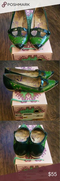 Irregular Choice Flats Size 6 Gently used green flats with pink bottoms and a pink and purple safety pin pattern. Worn twice, in great condition. Narrow in the toe area. Comes with replacement heels and original box. Irregular Choice   Shoes Flats & Loafers