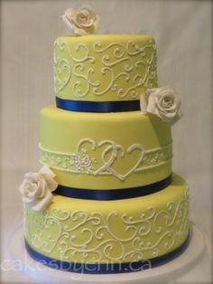 A Bold Yellow and Blue Wedding CakeCakes by Erin