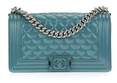 Chanel Blue Patent leather Boy Bag is a great Chanel statement bag! Featured in gorgeous blue patent leather, this medium boy bag features a thick silver toned chain and blue and silver boy lock closu