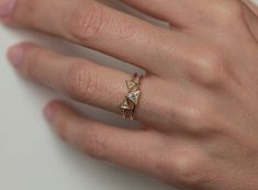 Listing is for set of 2 rings. Very unique!  IF YOU WANT A CUSTOM ring please contact me before purchase. Ring set can be also made with other stones.  Product details:  - 18k solid gold - 0.2 carat trillion diamond  - 0,10 carat trillion diamond - 2x  - band Width:1.5mm  Sizes available: 3.5-8 (Larger and smaller sizes are available. Priced upon request) Please note needed size when checking out.Metal Available: 14/18kt yellow gold (priced as shown), 14kt/18kt white gold, 14kt/18kt yellow…