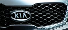 Grill | 2013 Kia Sorento Picture - The Sorento is equipped with Kia's signature grill and wraparound headlamps that give all newer Kia models an aggressive stance and sleek profile.