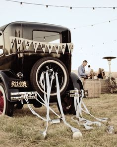 At the end of their celebration in California, this pair rode off in a decked-out Ford Model A.