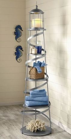 This stylish lighthouse storage rack will look great in a nautical bathroom.
