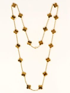 """Van Cleef & Arpels 18K 20 Motif Tiger's Eye Alhambra Necklace. Yellow Gold Necklace with 20 Tiger's Eye Clover Motifs. The Necklace Measures Approximately 34""""."""