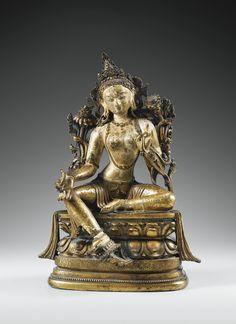 A VERY RARE AND IMPORTANT GILT-BRONZE FIGURE OF SHYAMA TARA, MONGOLIA, ZANABAZAR, LATE 17TH CENTURY.