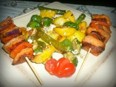 Grilled salmon skewers with roasted pattypan squash tossed with feta