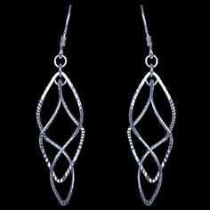 Silver earrings, spiral Silver earrings, AG 925/1000. Rhodium finished. Unusual spiral dangles earring s consisting of two undulating rhombs. Compelling surface finish - so called diamond cut, for heightening glittering effect. Dimensions approx. 18x56mm including enclosure. Price per pair.