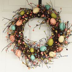 This handmade wreath, crafted using pip berries and pastel Easter eggs, signals to those entering your home that you're ready to celebrate spring!