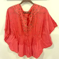Gorgeous Studded cinched poncho/blouse. Size Small Beautiful rare Romeo and Juliet Couture studded poncho/blouse with wide sleeves and  cinched elastic waist. Size small. In a summery coral color and subtle flower details. The pics don't do all the details on this top justice! It's been worn once still in excellent condition. Bought at Bloomingdales this was not cheap. Perfect as a coverup or paired with shorts. This summery blouse is a pop of color! Romeo & Juliet Couture Tops Blouses