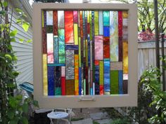 Antique and Repurposed Chicago Bungalow Window with NEW handmade Stained Glass Suncatcher. $333.00, via Etsy.