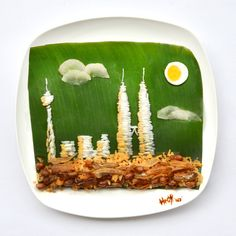 """Kuala Lumpur skyline in my nasi lemak!"""