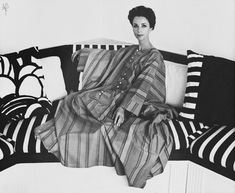 1970 by Cecil Beaton Gloria Guinness is wearing a Mexican striped djellaba with white button down front.