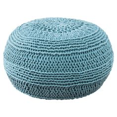 Showcasing a cable knit design in blue, this lovely pouf is perfect as an extra seat in your den or living room.  $127 Product: Pouf