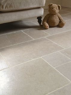 The stone has a warm creamy grey ground with subtle warm tones and occasional small pearlescent fossils are a feature. With it's tumbled edge and a lightly honed surface, it is an excellent choice for an aged flagstone look. | eBay!