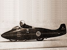 Burt Munro has his goggles around his neck, helmet is almost blown off and he is blinded by salt and wind when he sat up at to regain control. 1000 record of 165 mph. Burt Munro, Motorcycle Racers, Indian Scout, Speed Racer, Blow Off, Three Daughters, Old Bikes, Still Standing, Cool Halloween Costumes