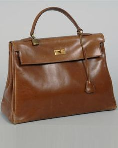 Grace Kelly - Her famous 'The Kelly Bag' - by Hermès - @Mlle