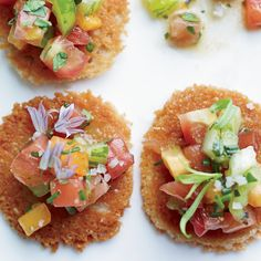 Chopped red, green and orange tomatoes are tossed with olive oil and herbs, then served on Parmesan tuiles. The result: a supremely colorful, incredib...