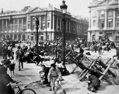 Crowds of Parisians celebrating the entry of Allied troops into Paris scatter for cover as a sniper fires from a building on the place De La Concorde. Although the Germans surrendered the city, small bands of snipers still remained. August 26, 1944. (U.S. Army)