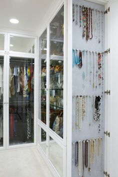 Use hooks or small knobs to organize jewelry.  This is such a great idea and they also added velvet to the cabinet behind the necklaces.  So smart.
