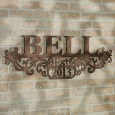 Display your heritage and take pride in your family name with the Kinship Bronze Family Name and Year Personalized Metal Wall Art Sign.