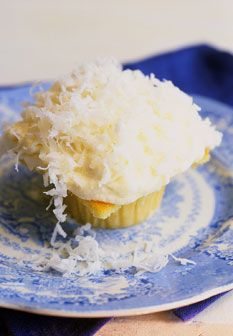 Coconut Cupcakes with Vanilla-Almond Cream Cheese Frosting....