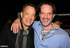 News Photo : Tom Hanks and Danny Mastrogiorgio pose backstage...