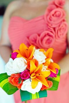 Coral and fuscia roses, orange lilies, and replace the white with a yellow or pop of dazzling blue. Like the leaf part as well!