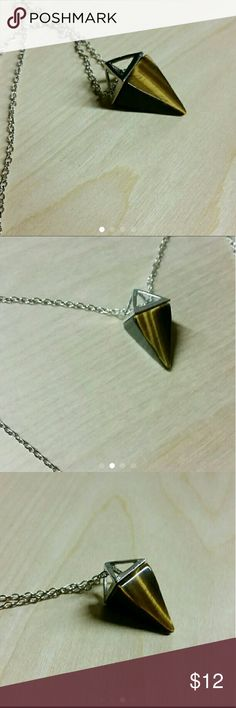 """Tiger eye pyramid necklace *natural tiger eye gemstone pendant  *Gorgeous cut and light reflection on 2 sides *Includes silver tone adjustable chain *1"""" long pendant,  pretty solid  This is a powerful stone that aids harmony and balance, and helps you to release fear and anxiety.   Trendy, fashion, jewelry, chain, necklace, choker, goth, emo, Victorian, steampunk, romantic, boho, bohemian, festival, metaphysical, crystal, stone, mineral, rock, Hipster, casual, grunge, collection, rituals…"""