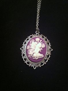 "Fairy cameo necklace On 16"" silver coloured chain $18"