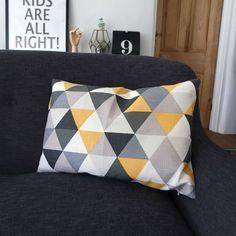 £25- Geometric Triangle Cushion In Yellow