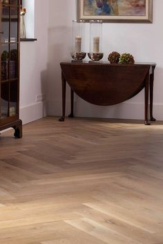 The herringbone pattern, probably the oldest parquet, with still-extant examples dating back to the mid-1500s. Herringbone hardwood floors may have been developed to mimic the herringbone decorative brickwork style that was common then. Here: classic with a modern twist.
