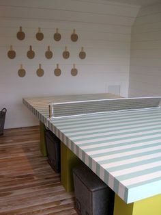 paddles on wall - decor for game room  Ping Pong Table - 2012 Coastal Living's Ultimate Beach House...gotta paint some stripes on the old table in the basement.  ---> love this pong pong table!!!