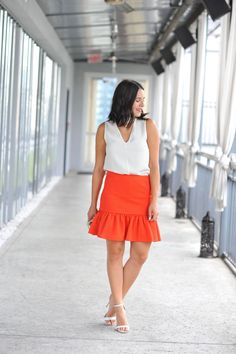 White top+orange peplum skirt+white ankle strap heeled sandals+ivory printed clutch. Summer date Night Outfit 2016