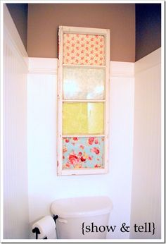 Pretty fabric/ scrapbook paper in an old window shutter...so easy and pretty. put pictures in it too!!