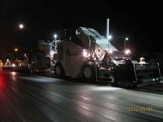 Shuttle Buggy - stores, mixes and transfers asphalt from truck to #hgparkway paver #MachineryMonday